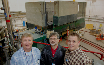 Perched on a Hall C equipment platform overlooking the new SHMS shield house are (from left) Branscome Concrete's Jack Kowalski, Hall C Senior Engineer Bert Metzger, and Essroc Cement's Jeremy Betts. PHOTO: Jefferson Lab