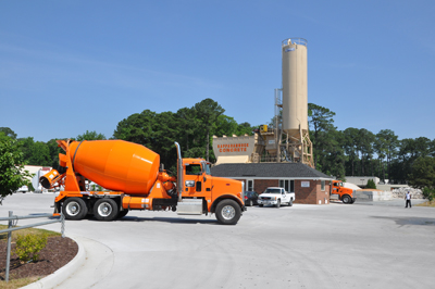 The Erie Strayer Model MP-11P has a maintenance platform for easy access to hopper gates on the 100-yd. aggregate storage bin, delivered with Z partition to net five compartments. Truck alley alignment with the bin limits the batch transfer conveyor length to accelerate mixer loading. The 1,150-bbl. silo, split in one-third and two-thirds, is equipped with internal ducting, 3-in. fly ash return pipe. Placement of the C&W dust collector on the platform opens up ground level space.