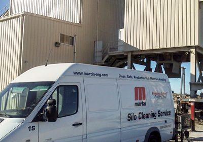 Martin Engineering silo-cleaning crew, the Commercial Acres RMC facility